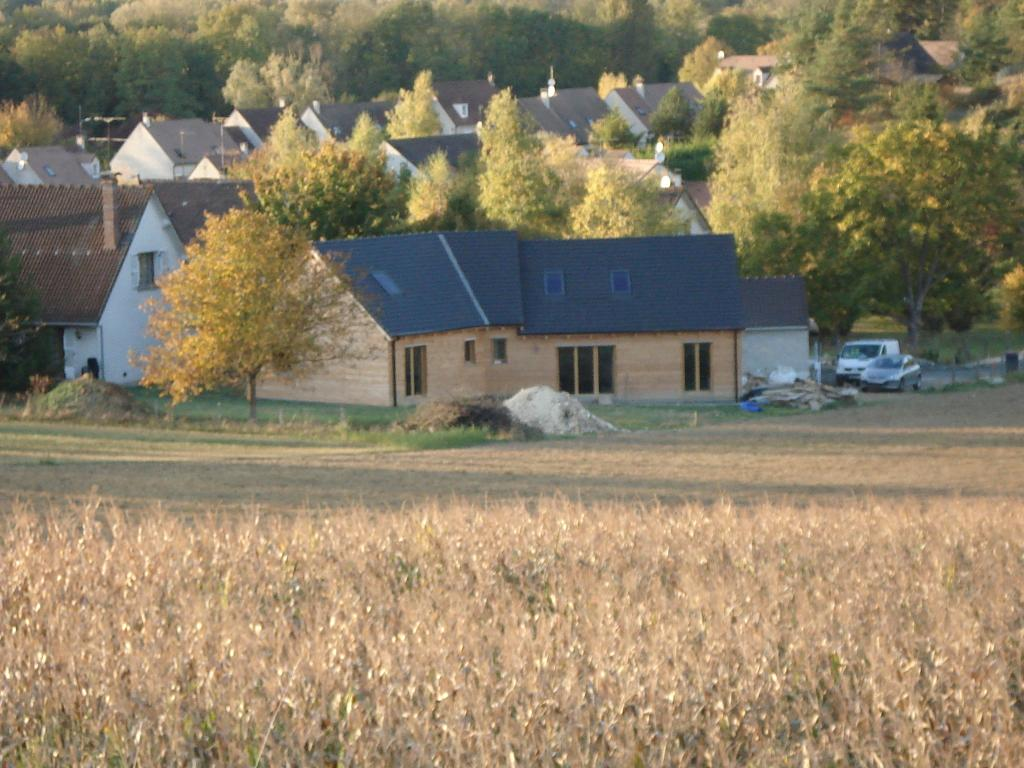 Maison ossature bois maison bois 77 en bois en kit for Ossature bois en kit