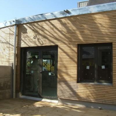 Bardage ch taignier sur maison ossature bois for Bardage maison ossature bois