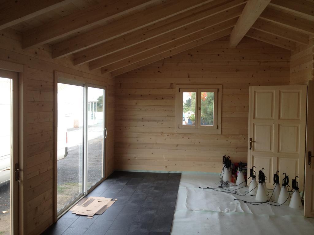 Maison bois de 66 m en bois en kit for Salon construction bois