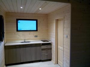 Photo Montage d'un studio toit plat avec mezzanine de 37 m2